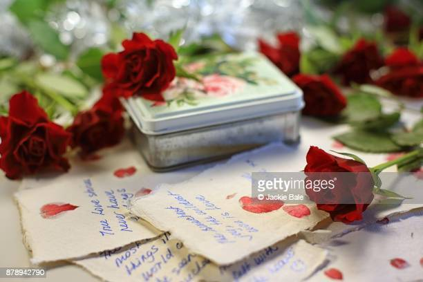 love letters and red roses - love letter stock photos and pictures