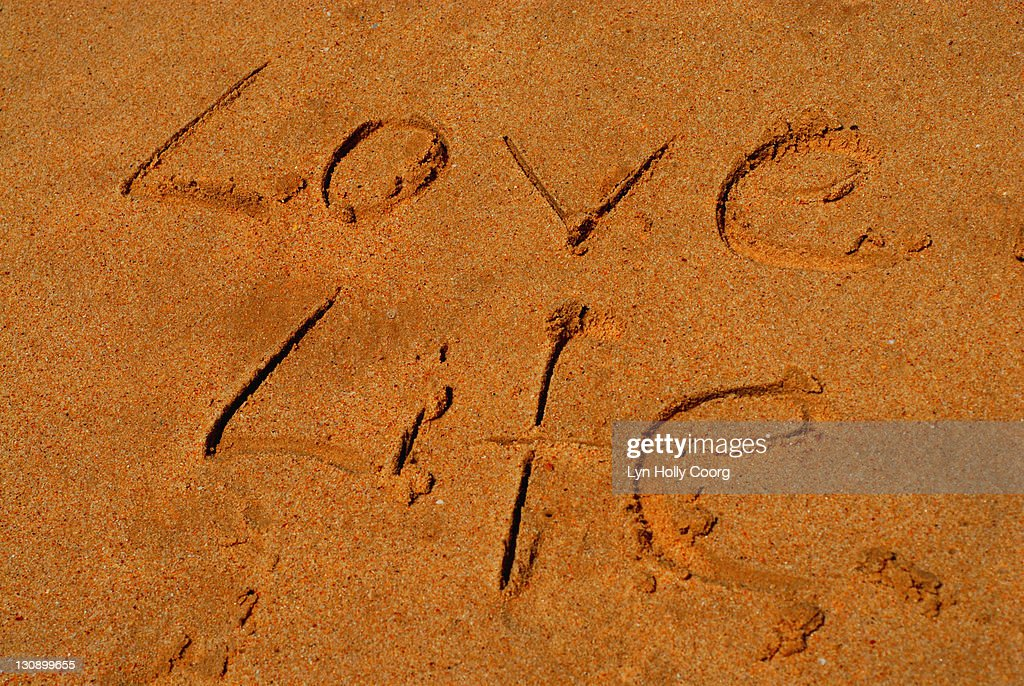 'Love Life' written in Sand : Stock Photo