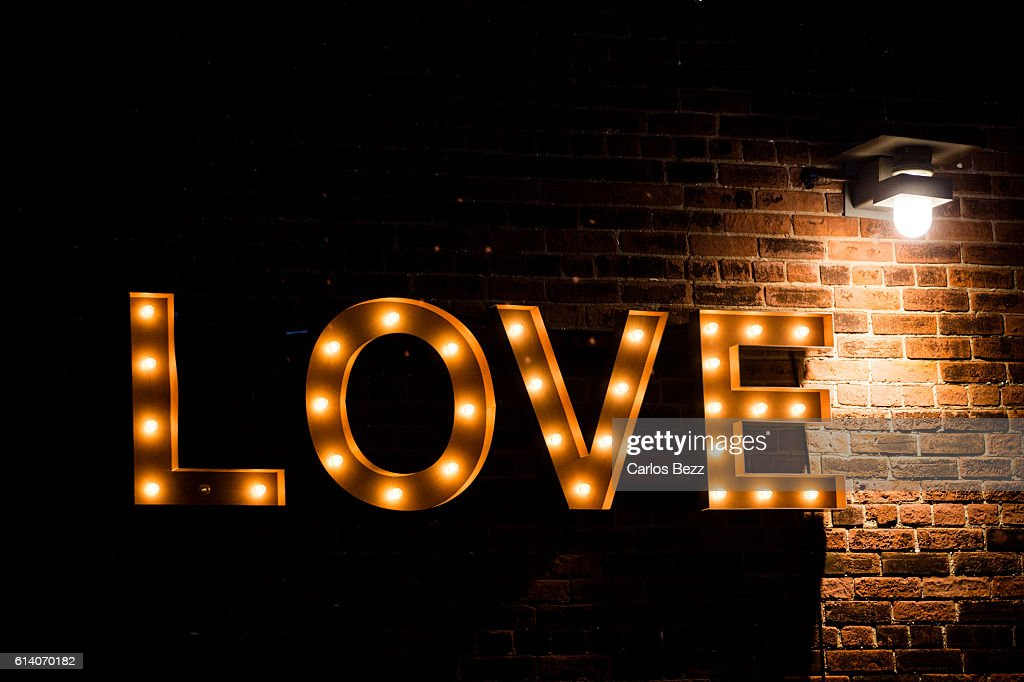 Love lightbulb sign on the wall stock photo getty images love lightbulb sign on the wall stock photo aloadofball Image collections
