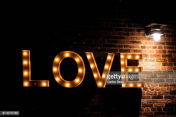 love lightbulb sign on the wall