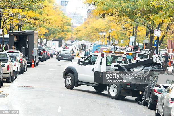 love local:  tow truck towing a car in boston - tow truck stock photos and pictures