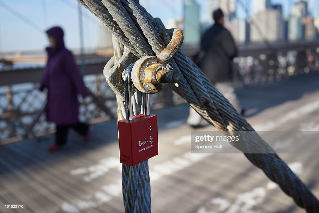 A 'love lock' is viewed on the Brooklyn Bridge, one of thousands that have been placed along the bridge recently on February 13, 2013 in New York City. The phenomenon has gained followers in recent years as couples seek to publicly mark weddings, engagements, and anniversaries in a permanent way. Besides New York, 'love locks' can be found on public monuments and bridges in Venice, St. Petersburg and Paris amongst other cities.