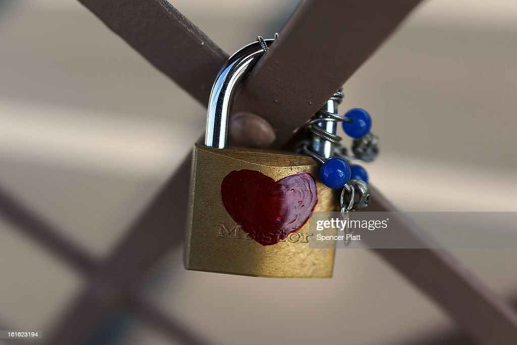 Couples Symbolize Their Love By Attaching Locks To The Brooklyn Bridge : News Photo