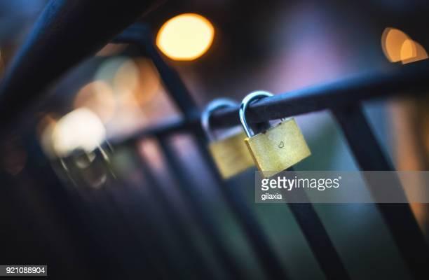 Love locks on a bridge fence.
