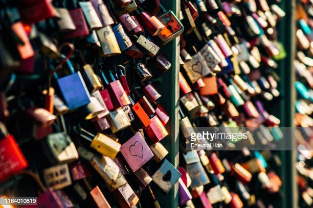 love locks on the hohenzollern bridge - padlock stock photos and pictures