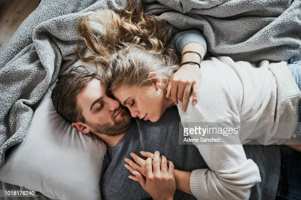 love makes for the sweetest of dreams - couple sleeping stock pictures, royalty-free photos & images
