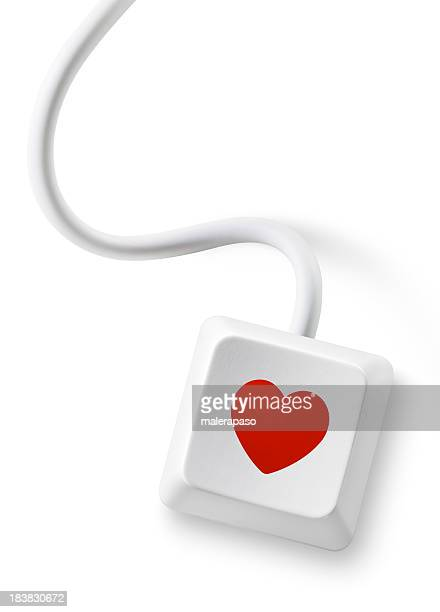 Love message. Computer key with heart.