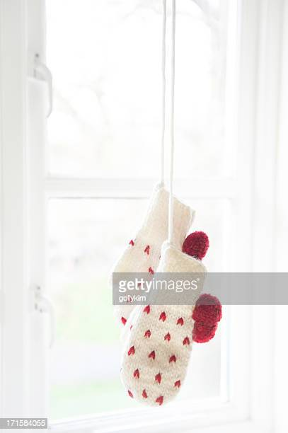 love mittens hanging by the window - mitten stock pictures, royalty-free photos & images