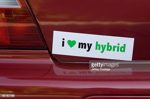 love my hybrid bumper sticker on car - bumper sticker stock photos and pictures