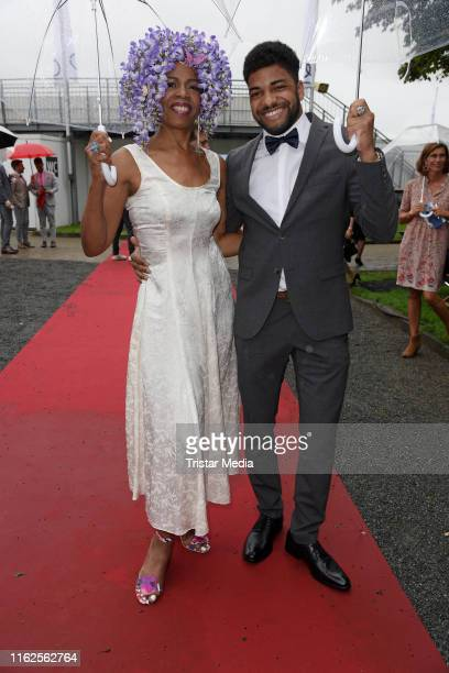 Love Newkirk and her son Isyah Newkirk Asher attend the Audi Ascot Race Day at Neue Bult horse racing track on August 18 2019 in Langenhagen Germany