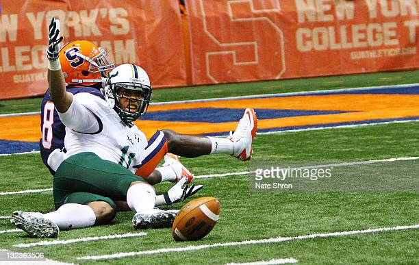 J Love of the South Florida Bulls looks for a flag after an incomplete pass caused by Keon Lyn of the Syracuse Orange during the game at the Carrier...