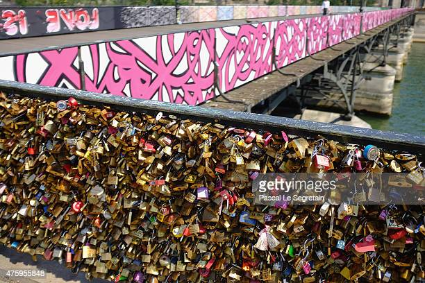 Love Padlocks are seen during Paris 'Love Padlocks' Replacement By Temporary Panels Signed By Graffiti Artists Brusk Pantonio Jace and El Seed at Le...