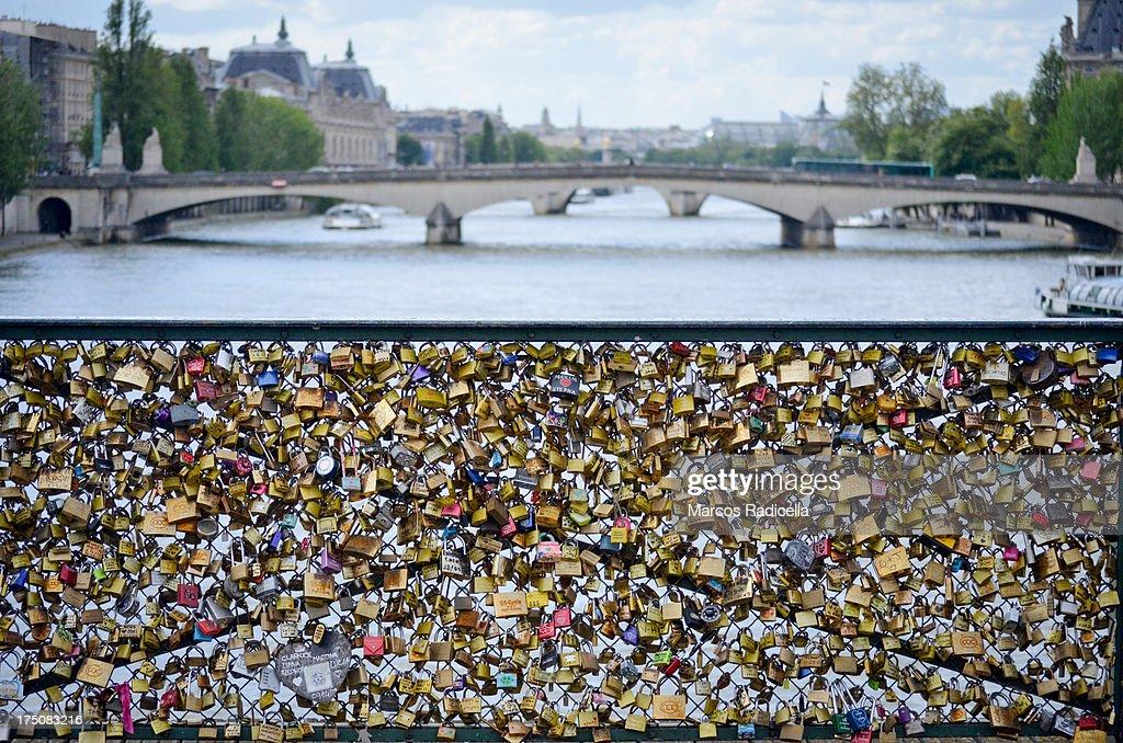 Love padlocks on bridge across the Seine : Stock Photo