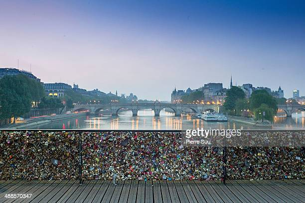 Love Padlocks on the Le Pont Des Arts bridge on May 7 2014 in Paris France In recent years Le Pont Des Arts has attracted tourists who visit the...