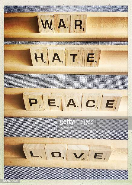 Love Peace War Hate Words Spelled with Scrabble Tiles
