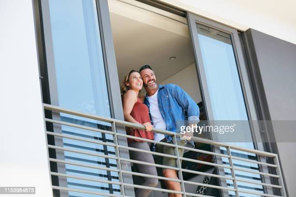 love puts you on top of the world - apartment balcony stock pictures, royalty-free photos & images