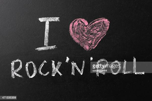 i love rock'n'roll chalk text on blackboard - chalk rock stock pictures, royalty-free photos & images