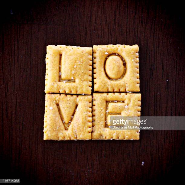 Love spelled with square crackers