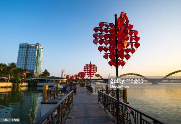 Love station near Dragon River Bridge ( Rong Bridge) in sunset