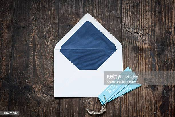 Love Tags And Envelop On Wooden Table