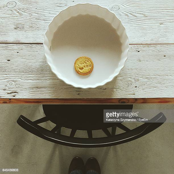 Love Text On Biscuit Floating In Bowl At Table