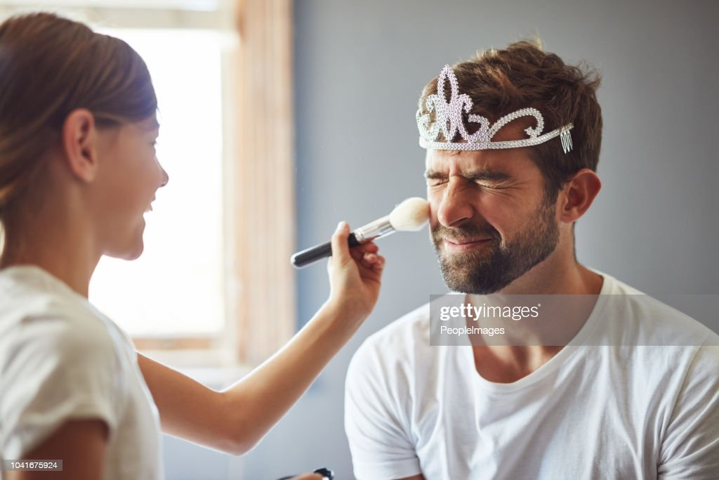 I love that Daddy plays dress up with me : Stock Photo