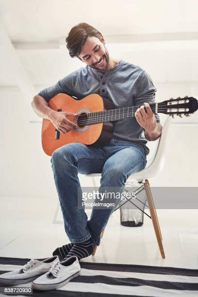 i love that feeling i get when i play guitar - guitar stock pictures, royalty-free photos & images