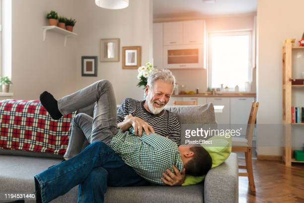i love this little guy - tickling stock pictures, royalty-free photos & images