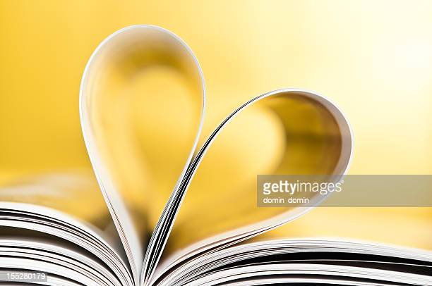 love to reading books, pages folded into a heart shape - love magazine stock pictures, royalty-free photos & images