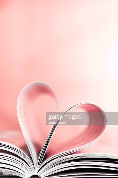 love to reading books, pages folded into red heart shape - love magazine stock pictures, royalty-free photos & images