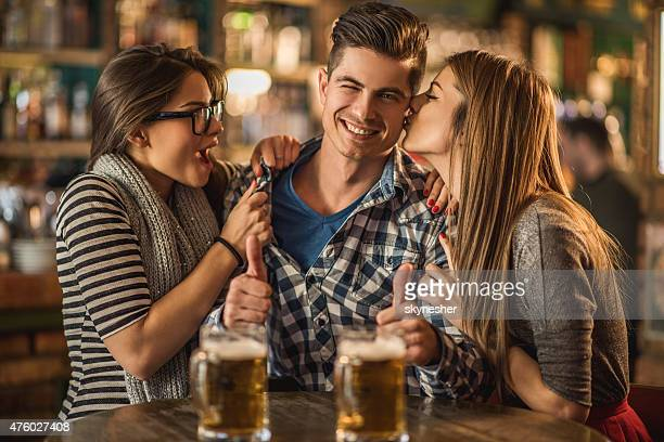 love triangle in a bar. - bigamy stock pictures, royalty-free photos & images