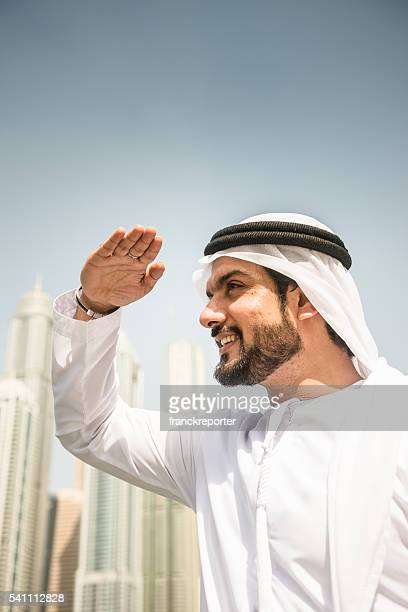 love, victory, peace typical greeting in uae - traditional clothing stock pictures, royalty-free photos & images