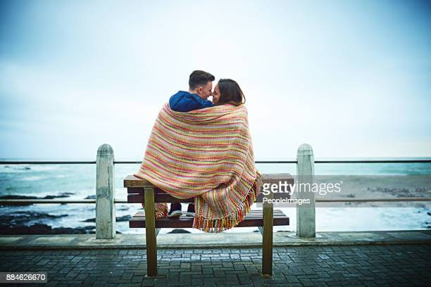 love will keep them warm - romance stock pictures, royalty-free photos & images