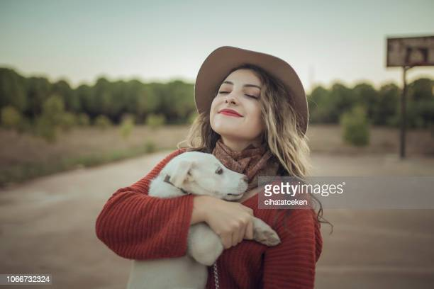 love woman embracing pet dog in nature - dog turkey stock pictures, royalty-free photos & images