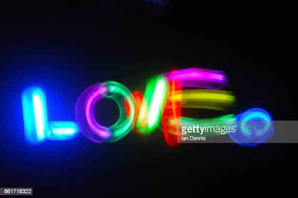 love written glow sticks - typographies stock photos and pictures