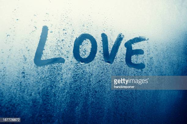 Love written on condensated glass for St. Valentine