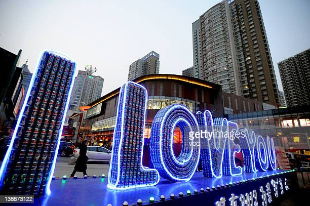 Love You' is formed by one thousand Pepsi soda cans at Dongzhong Street on February 12, 2012 in Shenyang, Liaoning Province of China. Preparations...