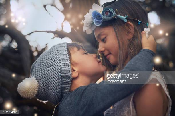 love you lots, big sis - girls kissing stock photos and pictures
