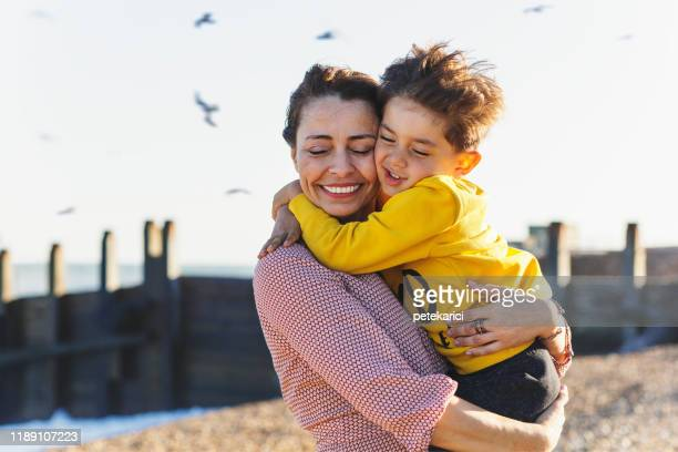 i love you mommy - embracing stock pictures, royalty-free photos & images