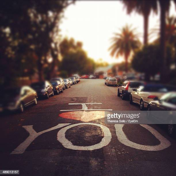 i love you painted on street - i love you photos et images de collection