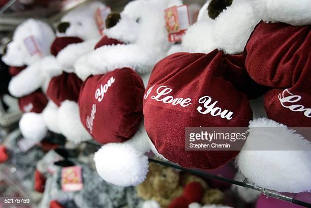 "Love You"" teddy bears rest on a shelf at a Hallmark store February 10, 2005 in New York City. According to retail projections, people will spend an..."
