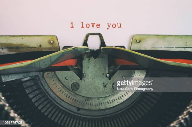 'i love you' typed by old typewriter - publisher stock pictures, royalty-free photos & images