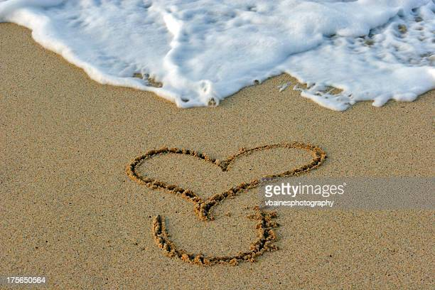 love you written in sand on the beach - letter u stock photos and pictures