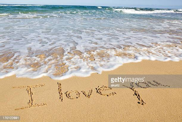 i love you written in the sand ocean surf - love you stock photos and pictures