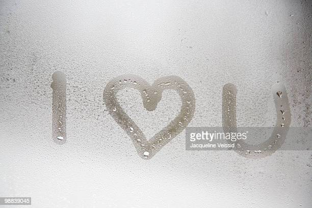 i love you written on steamed window - i love you stock pictures, royalty-free photos & images