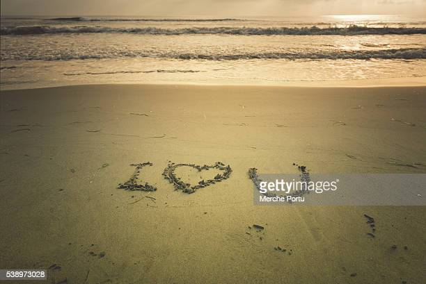 I love you written on the sand