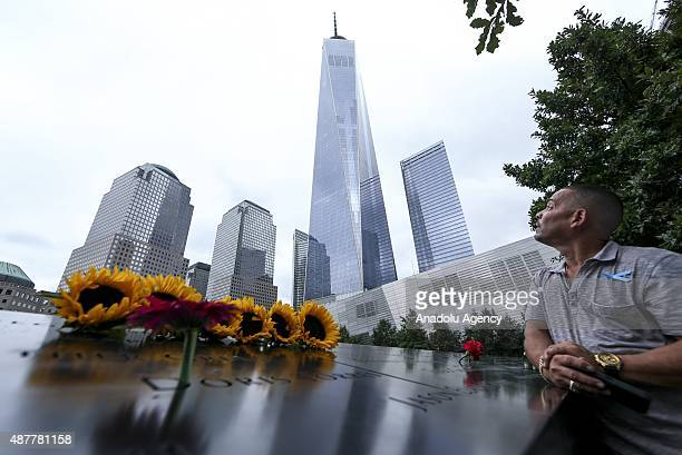 Loved ones pay their respects at the 9/11 memorial for those killed on the 14th anniversary of the 2001 terrorist attacks at the site where two of...