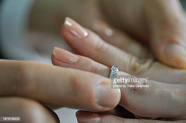 love/hands - man holding engagement ring stock photos and pictures