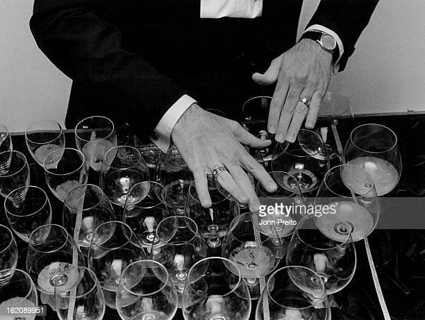 DEC 18 1986 Loveland Colo Norman Rehme Builder and player of glass harp series of glasses played by running fingers around the Rim
