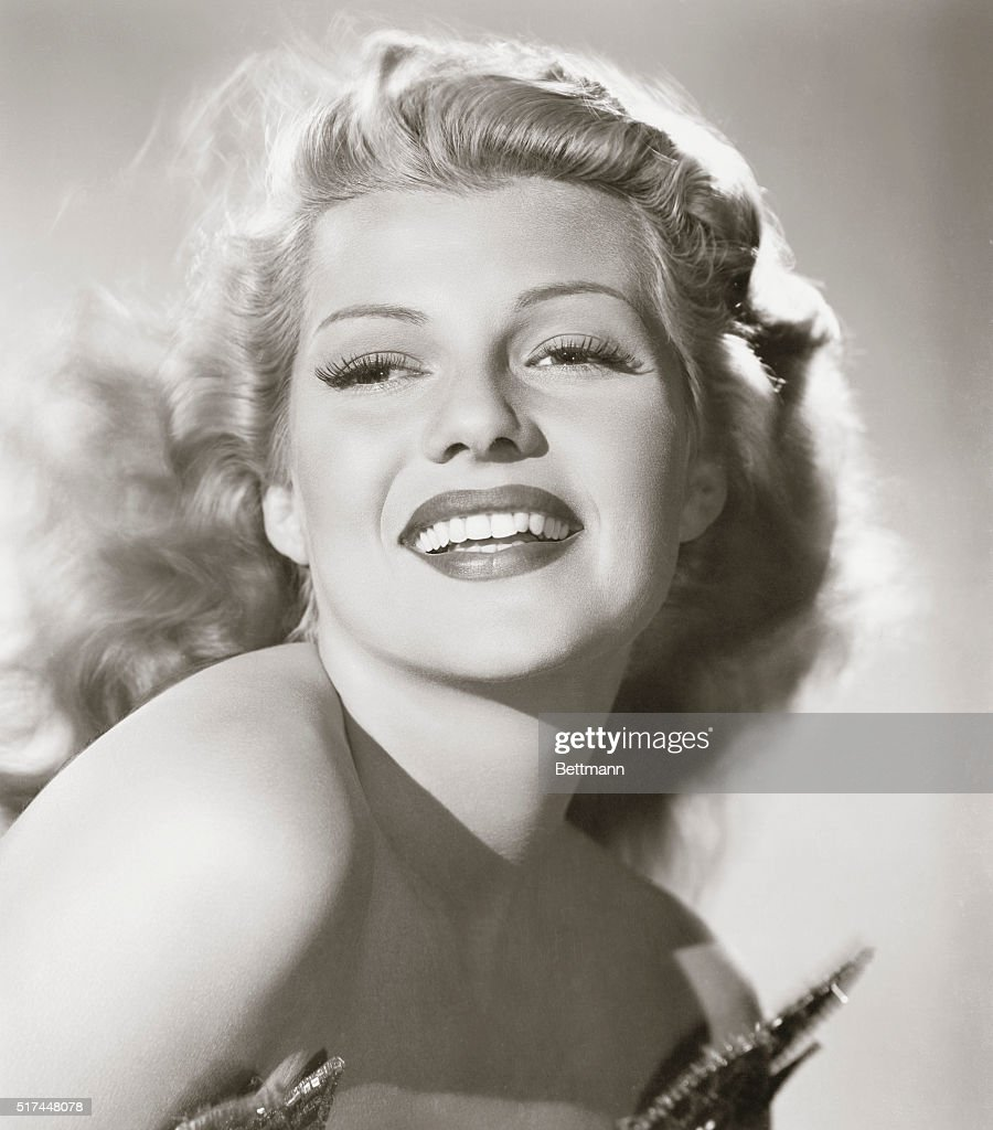 Columbia's Rita Hayworth, who stars in the technicolor Down to Earth, with Larry (Jolsen) Parks playing opposite. The film marks Rita's return to the lavish musical and dancing picture of the 'Cover Girl' type, after her straight dramatic role in the spectacularly successful Gilda.